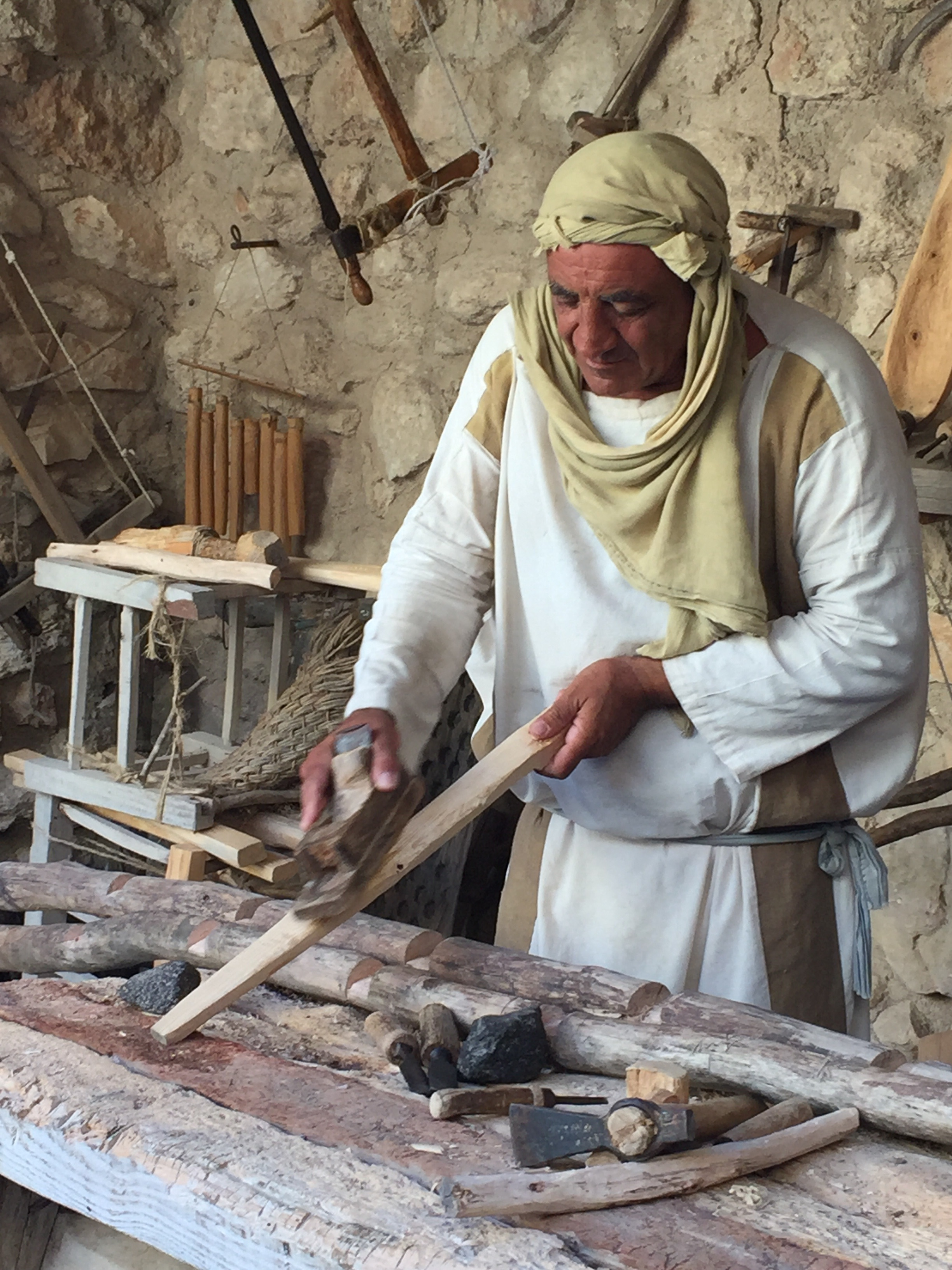 """""""Joseph"""" planing the rung of a ladder he was making using tools from the first century."""