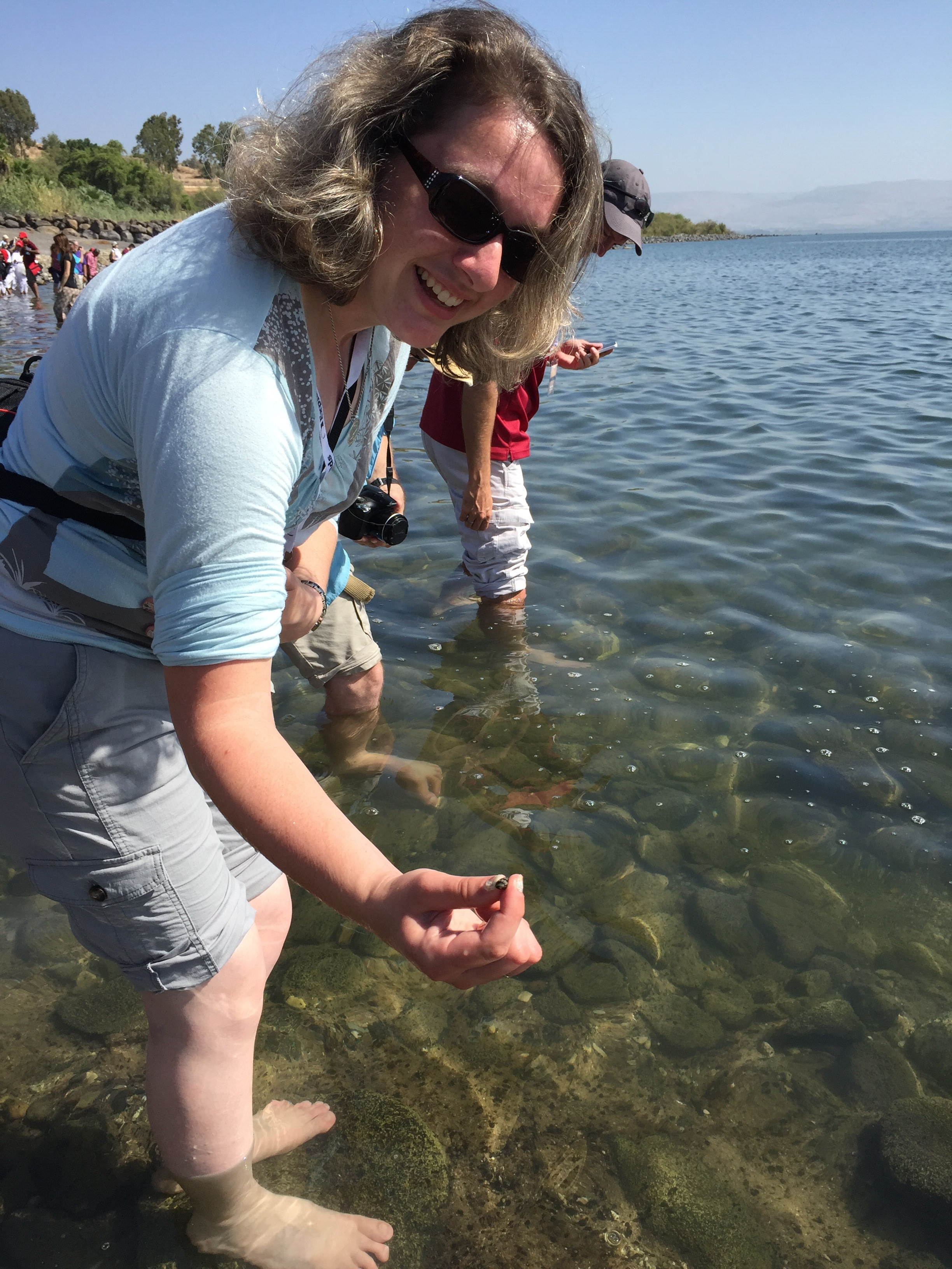 Anna showing me one of the small snails in the lake.