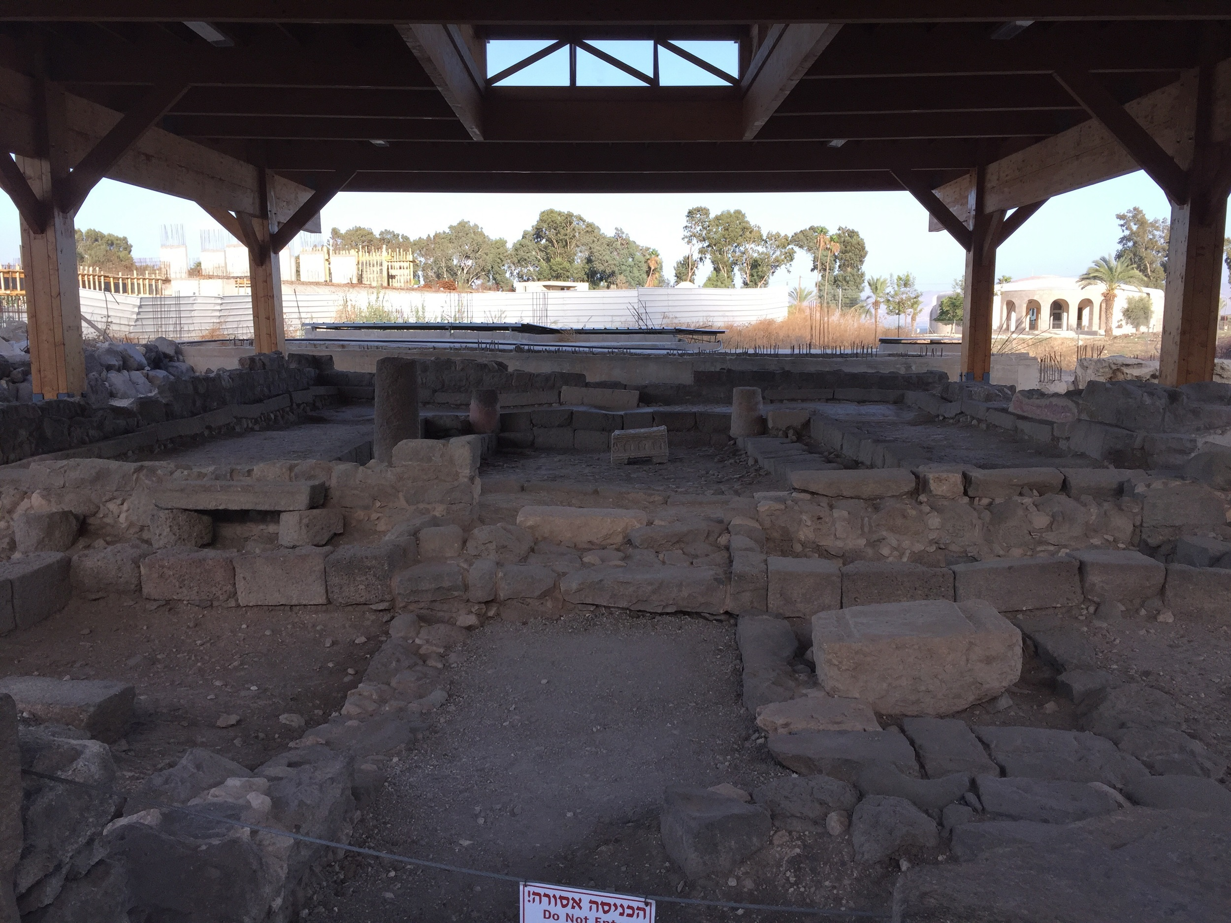 The first century synagogue of Magdala. The Magdala Stone is the lighter colored, small box in the back of the synagogue. (This Magdala Stone is a replica. The original is being temporarily kept at a museum until this original site becomes more secure.) They speculate that the stone is the base of a first century podium, which would have been used to assist those reading the Torah.