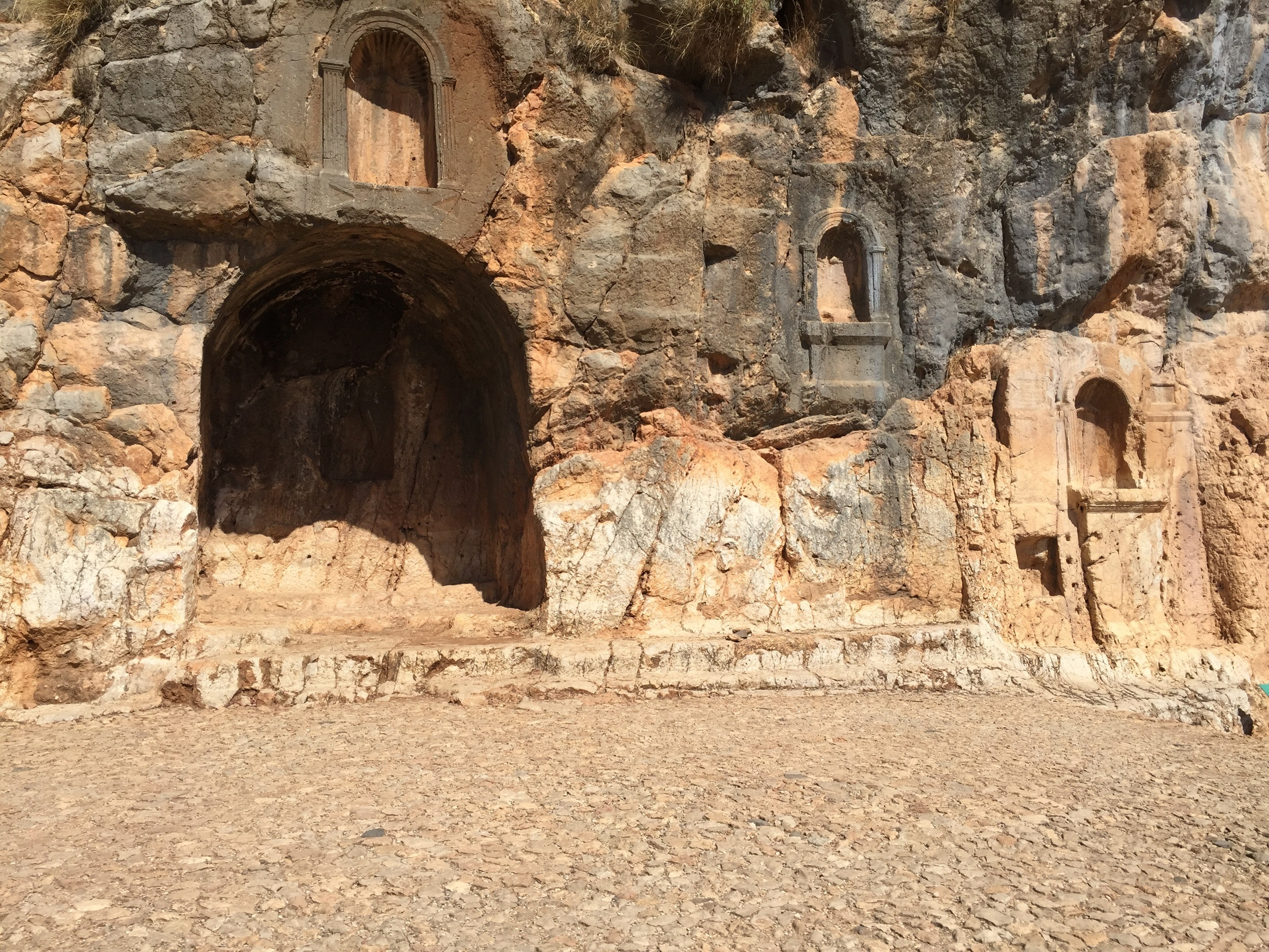 Some niches in the cliff wall where statues used to rest. This cliff wall was the rear of the temple.