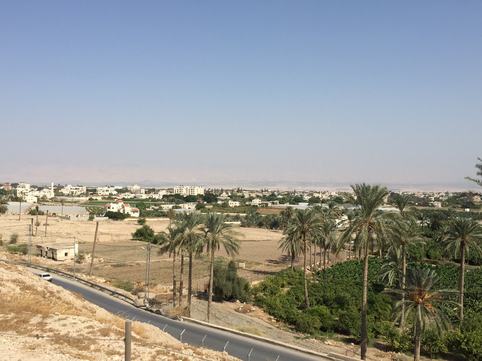 From on top of Tel Jericho looking east toward the Jordan River valley. The river is just beyond the buildings in the background.