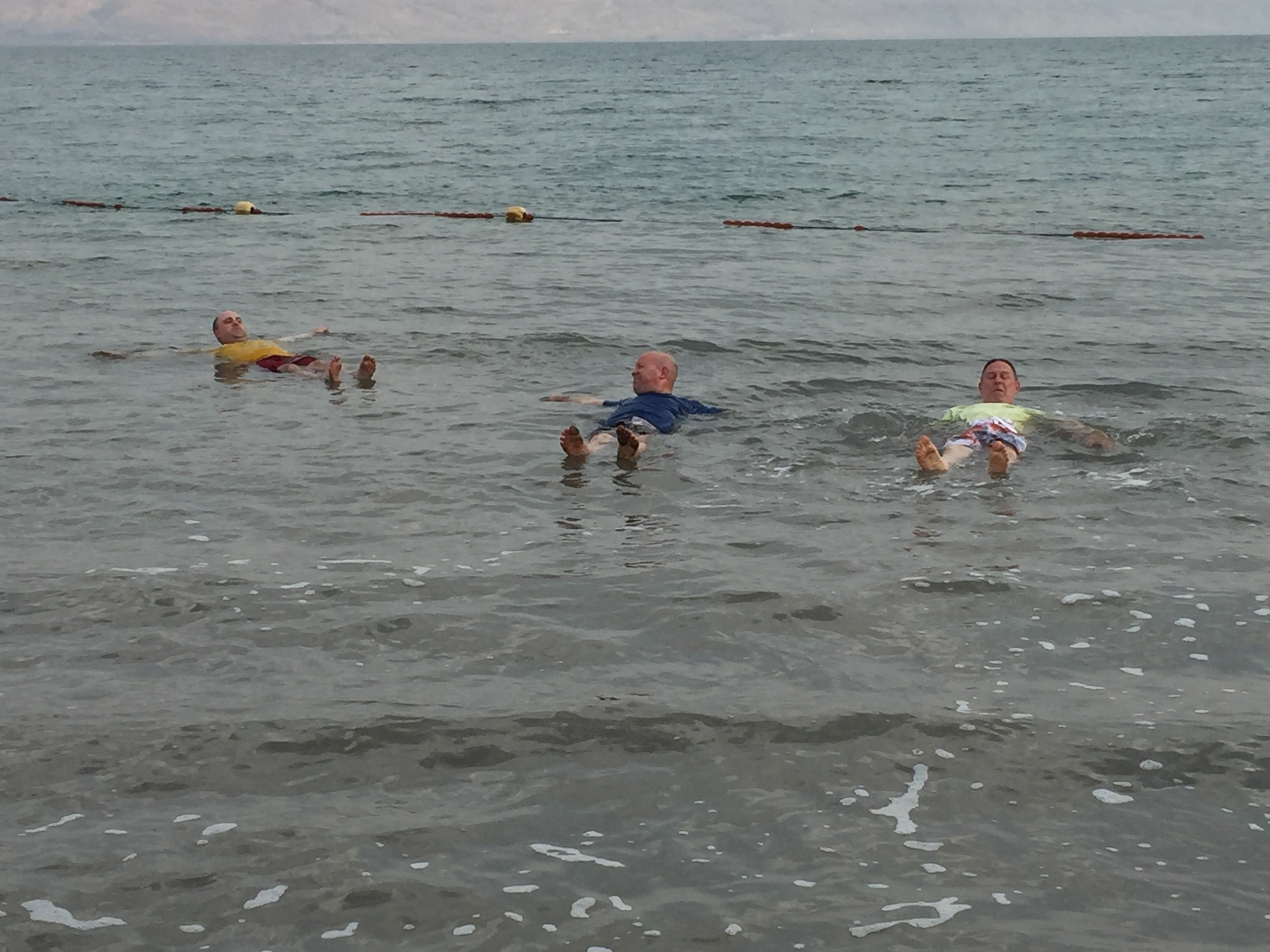 Several of us bouyantly floating in the Dead Sea.
