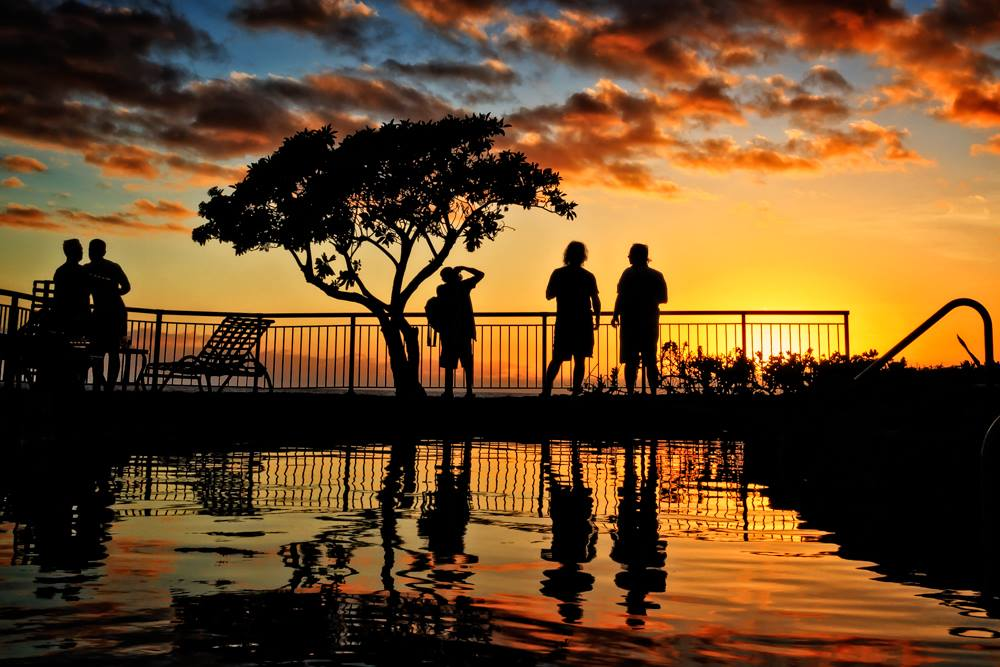 Puttering at sunset in Poipu Beach, by Avi Nahum.