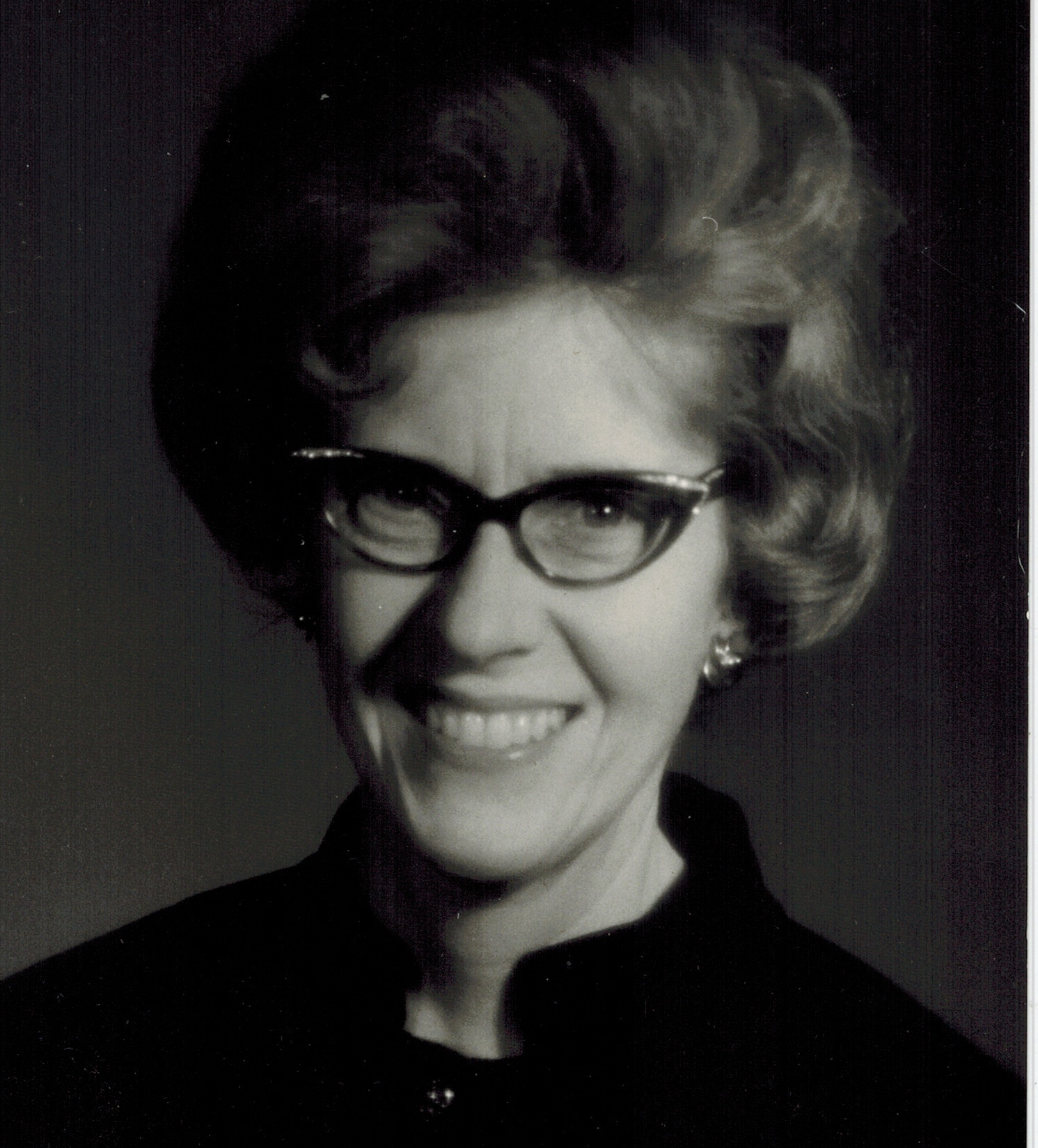 One of Mom's favorite photos taken by my Dad for her music teaching publicity - I love the 1960s hairdo.