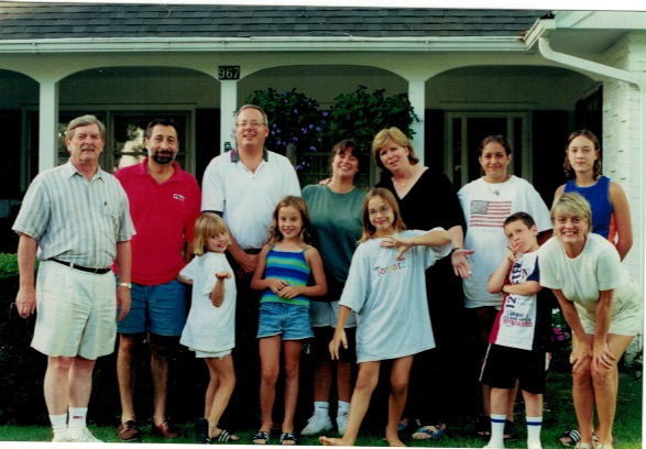 A mid-1990s Dick Wink, on the left , with the families he inspired with humor and love.