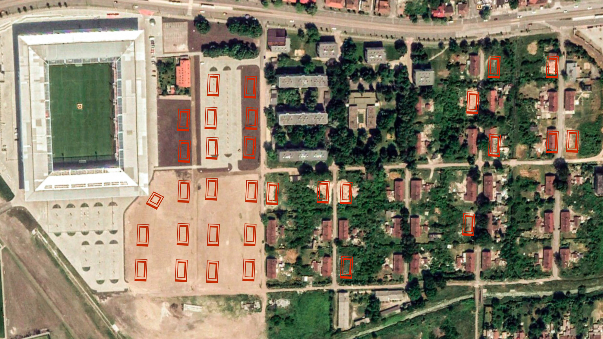 After: A satellite shot from 2018 shows the new stadium with a parking lot and empty fields where 20 houses once stood. The city continues to evict Roma as they can, and tear down homes far from the stadium, as the red rectangles — destroyed and partially destroyed homes — throughout the Numbered Streets indicate.