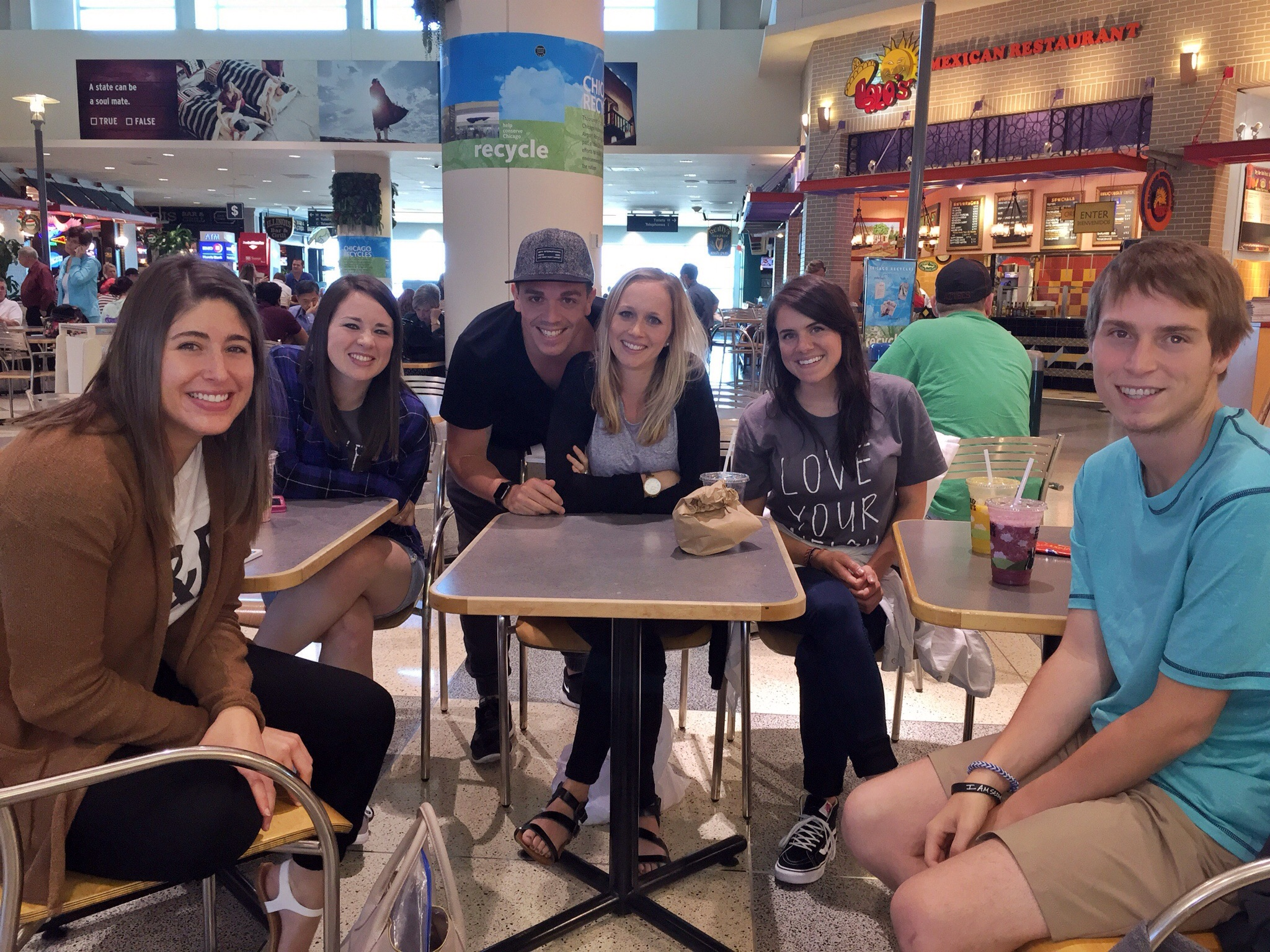 "This was my travel team, waiting for our layover at the Chicago Airport! We were appropriately named ""The Pizza Group""!"