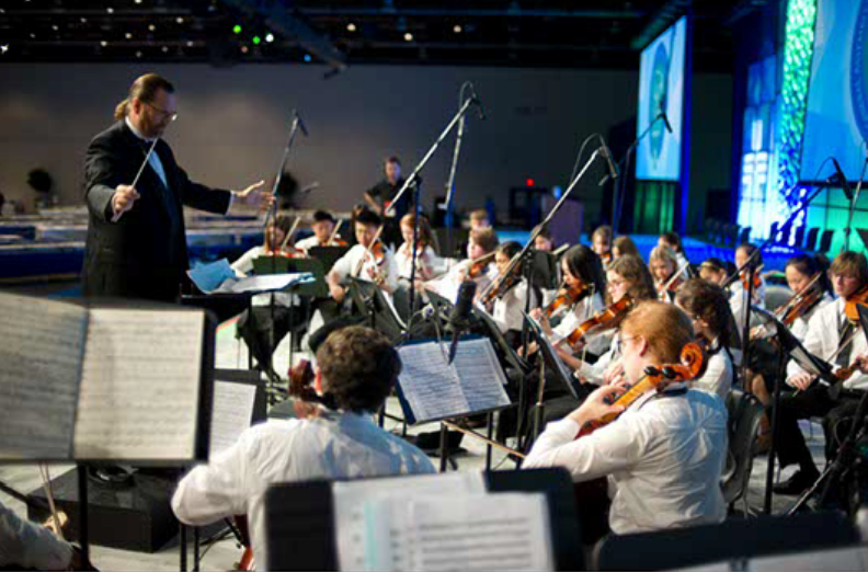 Conductor Geoffrey Benes rehearsing at the General Assembly with the Detroit MYS Select Orchestra, picture courtesy of ericperryphotography