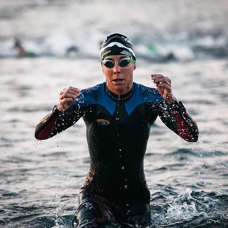 swim workout swimming triathlete swimmer water wetsuit triathlon