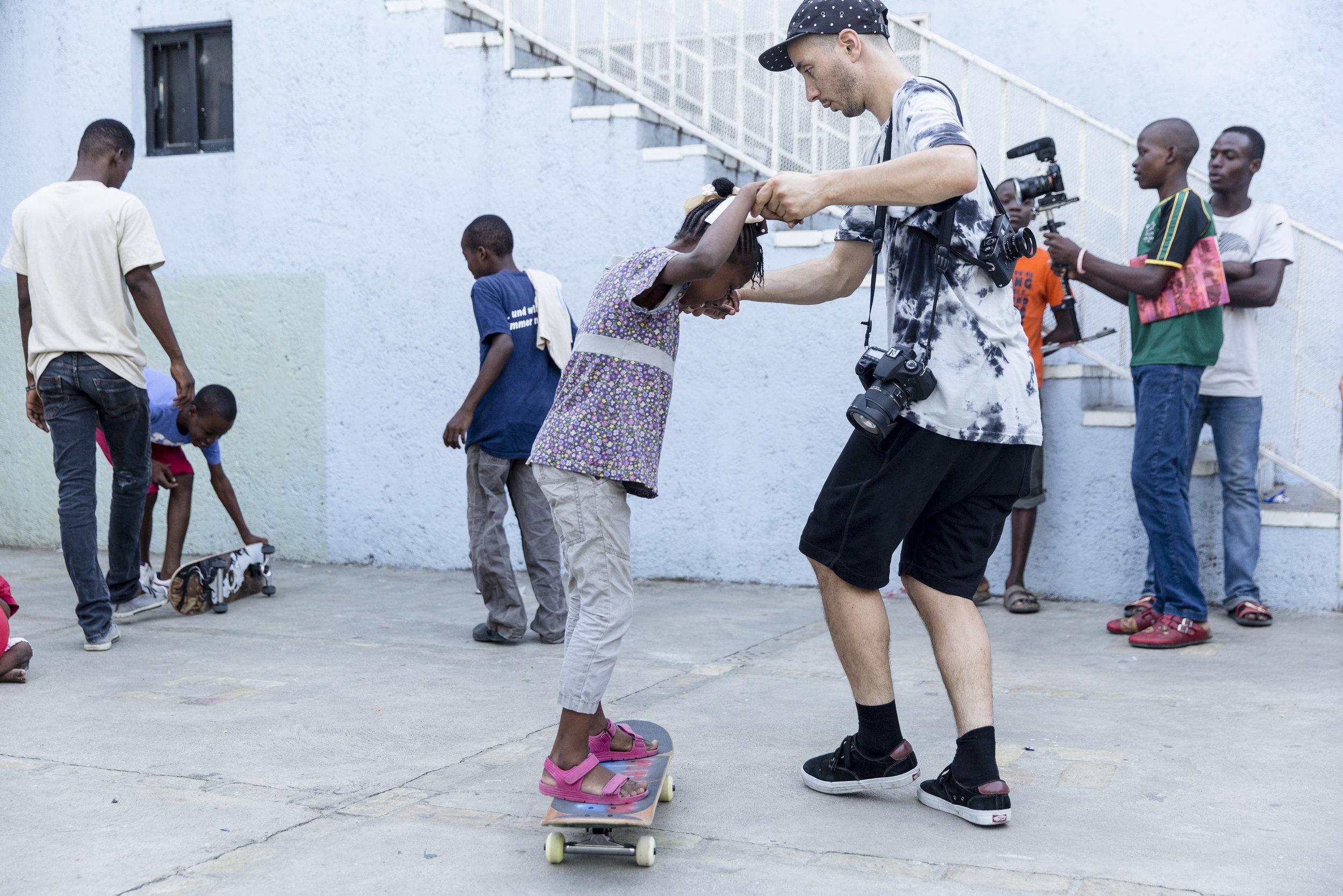 Amigo media specialist Chris Miller putting down the cameras for an impromtu skateboard lesson.  Photo: Matt Roy .