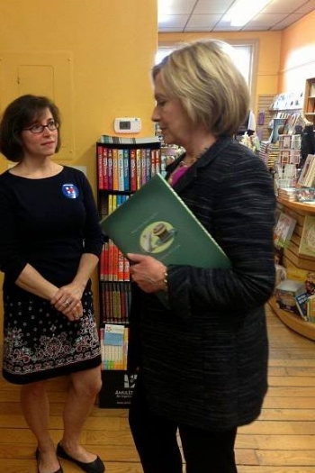 Oh, hey, Hillary Clinton. We see you have a copy of Mike's book. We approve.