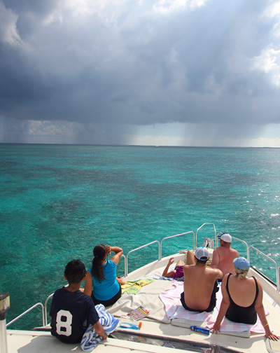 Storm and sunshine while on tour in Grand Cayman