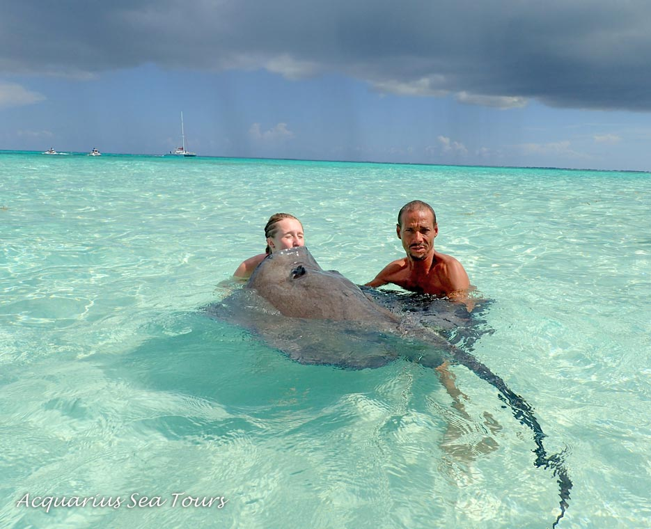 Kissing quickly before the rain hits us ... Stingray City in Grand Cayman