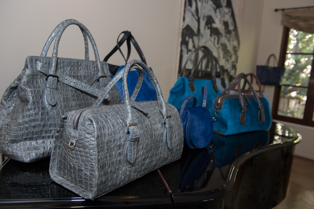 Exotic treatments in Italian leathers: embossed croc, and cobalt and cerulean calf hair.