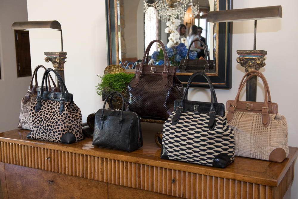 An elegant display of  Paris Totes  and a  Rousseau Satchel .