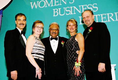 2004 Applause Award Winner Dr. Renaldo Jensen and the Ford Motor Company Supplier Diversity  Development Team.  From left to right  : Andy Benedict, Executive Director, Facilities, Materials &   Services Purchasing; Lori Hines, Manager, Supplier Diversity Development; Dr. Jensen; Debbie  Murdie, Manager, Supplier Diversity Development; and Steve Larson, Manager, Supplier Diversity  Development.