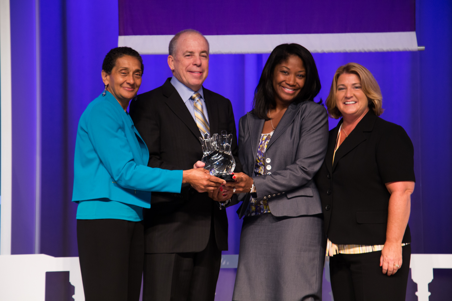 Presenting the Applause Award     Left to Right: Benita Fortner, Chair WBENCBoard; Larry Caldwell, VP IT & CorporateServices Procurement, PepsiCo; Eyvon Austin,Global Supplier Diversity Director, The Coca-Cola Company; Pamela Prince-Eason,President & CEO, WBENC