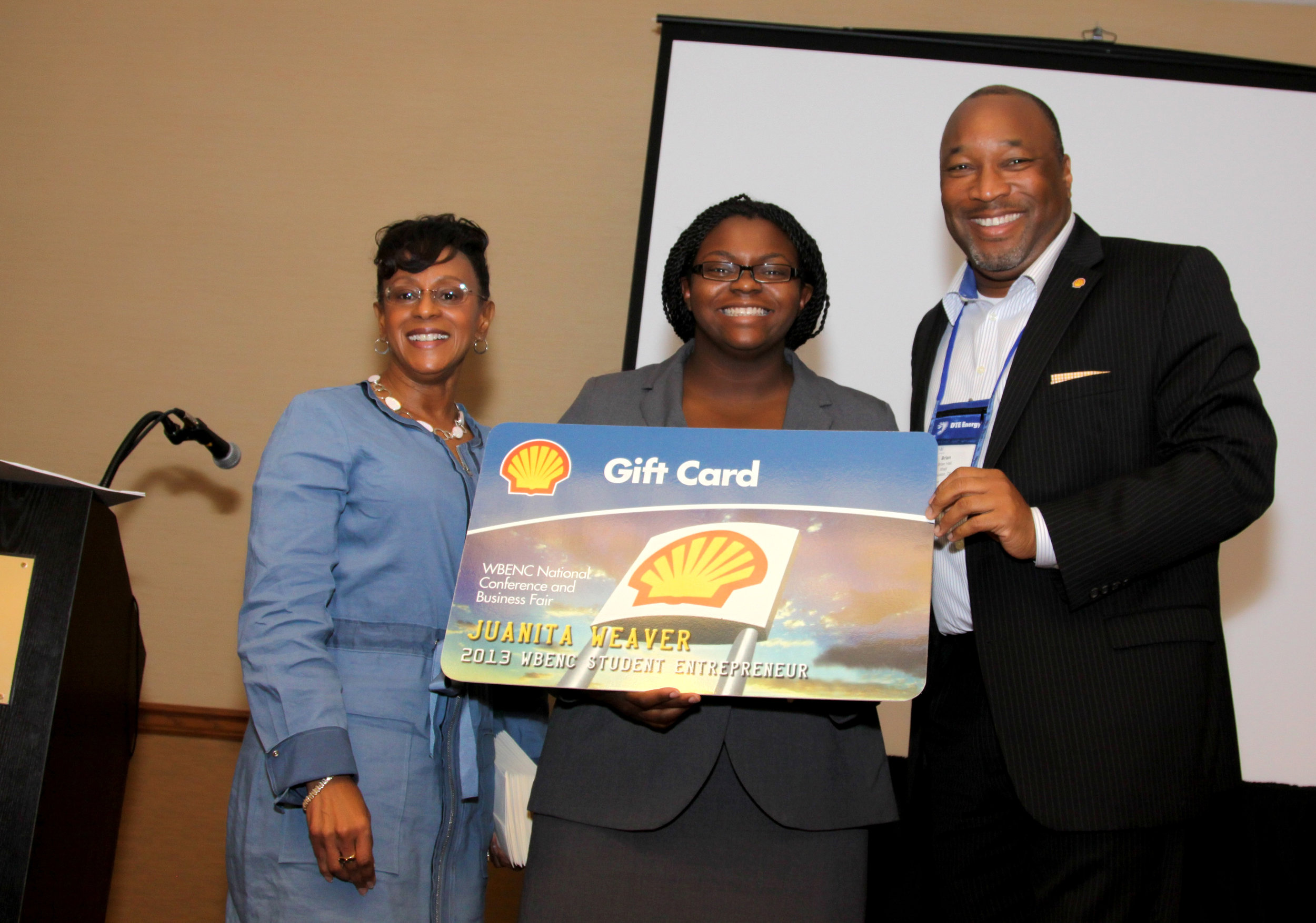 Juanita Weaver (center) with representatives from Shell.