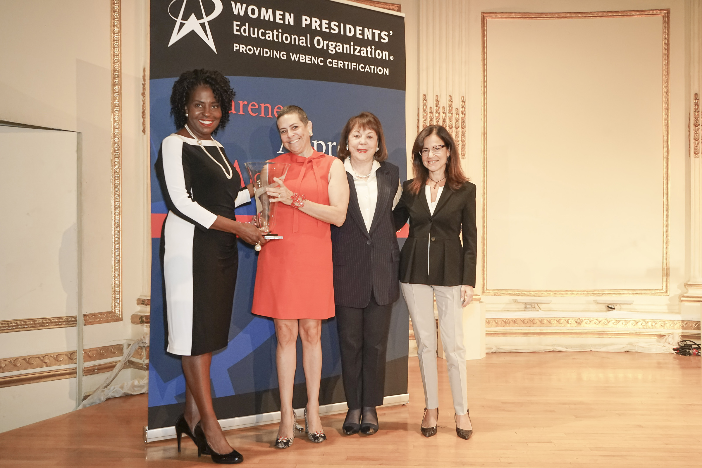 """Alexandra Lebenthal, CEO, Lebenthal & Co, LLC accepting the Corporate Champion Award on behalf of Microsoft Corporation."""" Pictured left to right: Avis Yates Rivers –Vice Chair WPEO Board of Directors and CEO, Technology Concepts Group International, LLC; Alexandra Lebenthal, CEO, Lebenthal & Co, LLC; Dr. Marsha Firestone, President and Founder, WPEO; Susan Feiner, Vice President Enterprise Supply Management, Capital One"""
