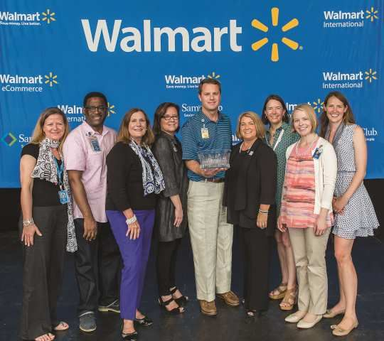 Walmart President and CEO Douglas McMillon, center, received WBENC's Crystal Leadership Award from WBENC President & CEO Pamela Prince-Eason, fourth from right, on June 6, 2015 during Walmart's Saturday Morning Associate Meeting as part of the annual shareholder's meeting.    Photo: WE USA