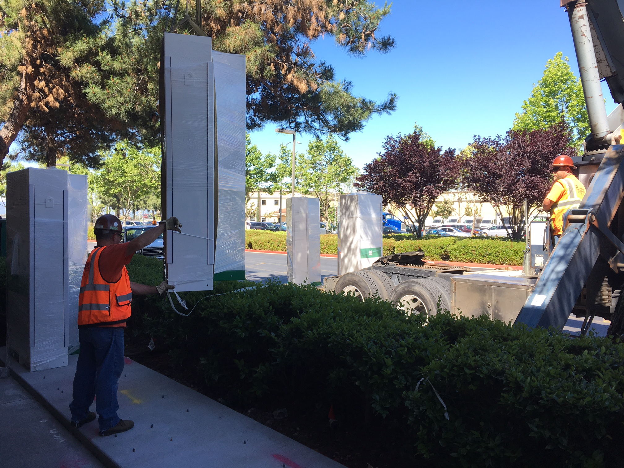 Battery systems from Green Charge are installed at a supermarket in San Jose. The installation is a part of PG&E's technology demonstration to test battery storage and rooftop solar connected to smart inverters that will support the electric grid during periods of high electric demand while providing participating customers with backup power and bill reduction.