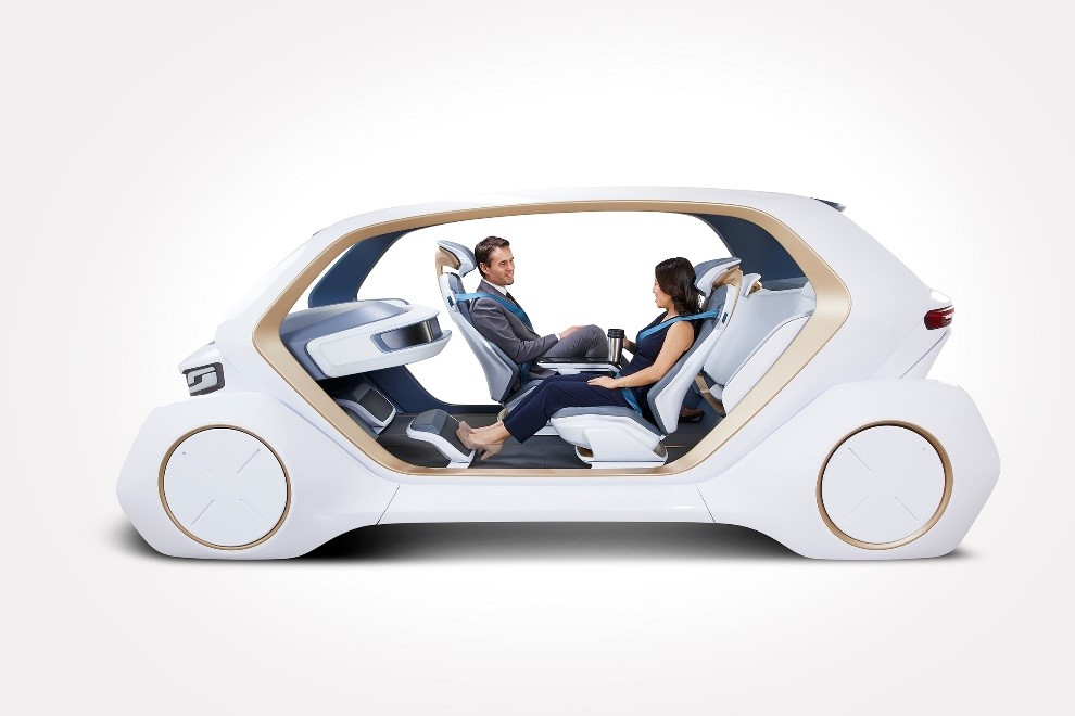 """When configured into conversation mode, the vehicle becomes a mobile meeting space. The front passenger may turn 180 degrees so the driver and passenger can talk facing each other. To enable this, Adient is developing a new form of kinematics for the seating platform that lifts slightly so it can turn in a compact interior space. All seating functions and vehicle settings are controlled via an operating panel integrated into the driver's seat so the seat increasingly becomes the """"command center."""""""
