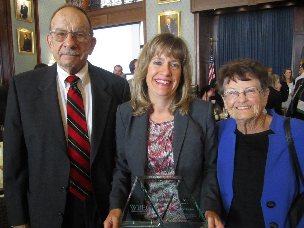 Peggy receiving an award from WBEC PA-DE-sNJ with her parents Charles and Helen Davis,