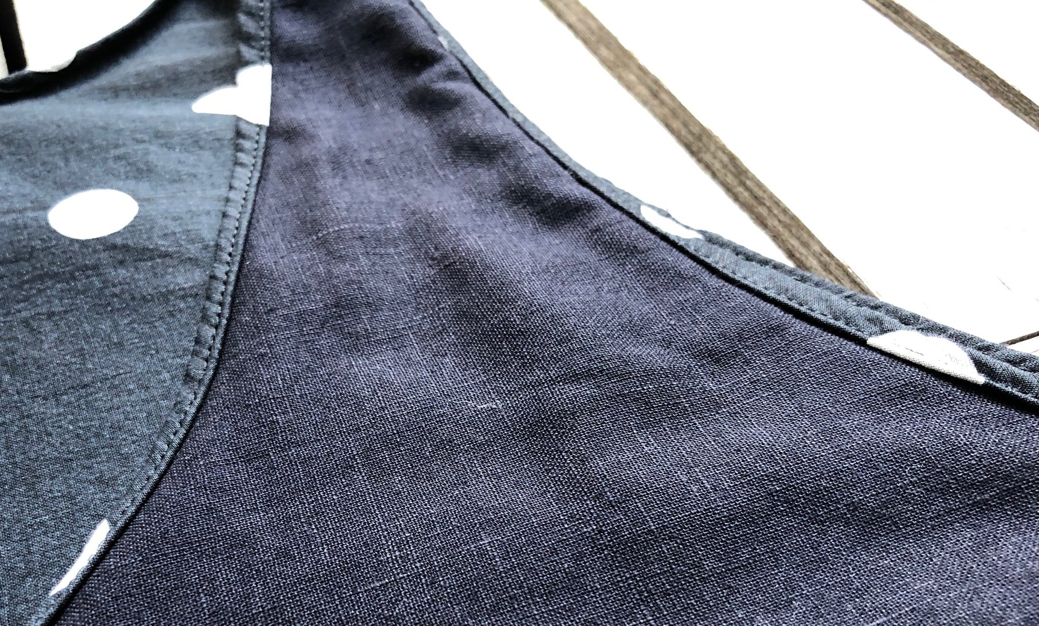Black linen underlines the cotton woven fashion fabric of the Slip Dress.
