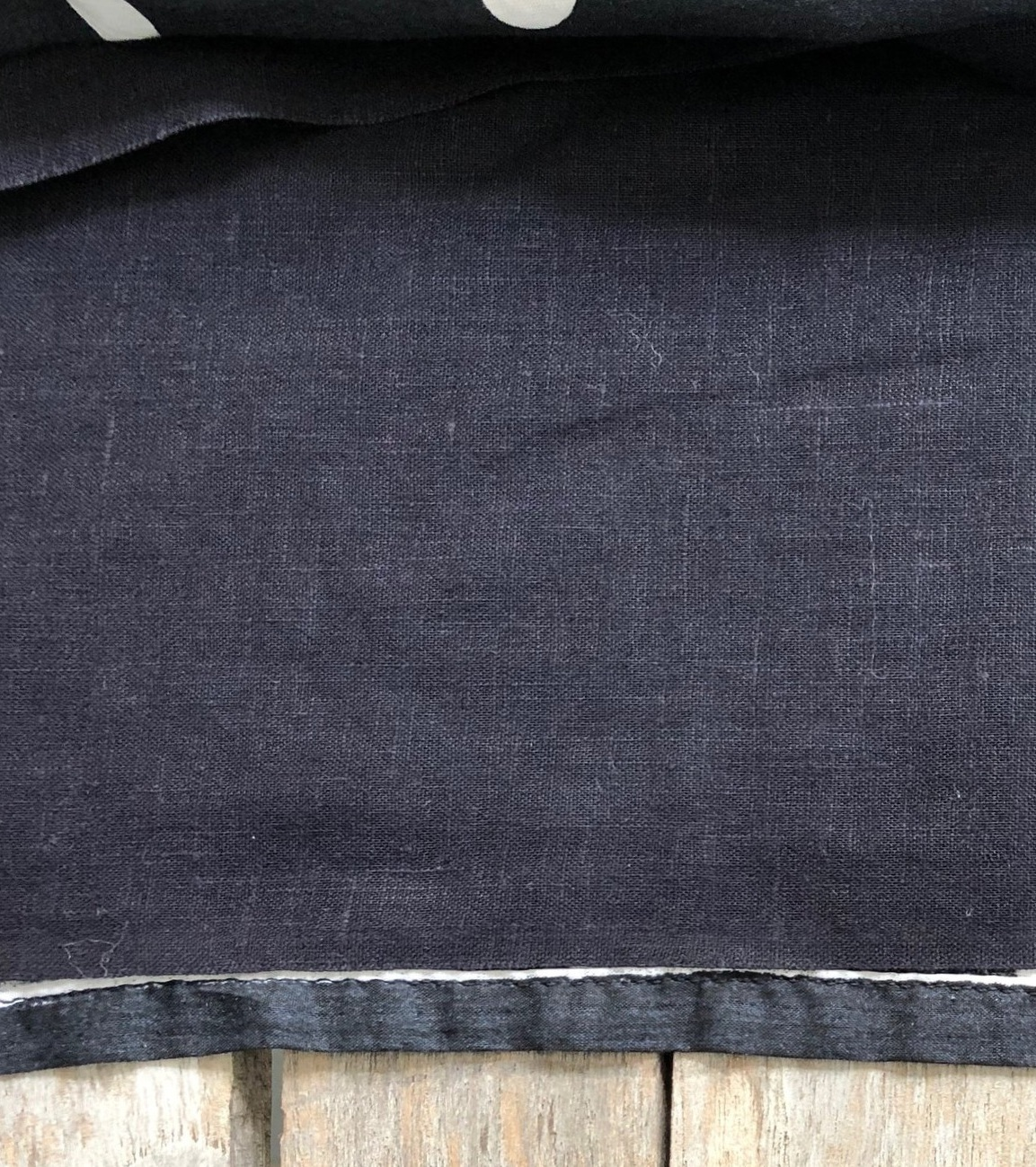 """Cut the underlining fabric crosswise 1"""" shorter than the fashion fabric to create a smooth finish."""