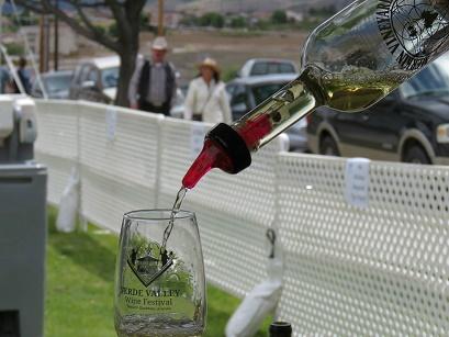 A festival attendee enjoys a sample of Merkin Vineyard's Shinola Blanca.