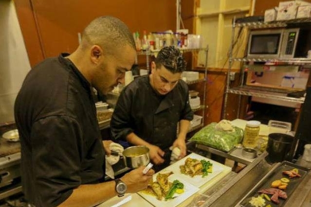 Chef Christopher Smith now with Merkin Vineyards Tasting Room and Osteria preparing cuisine at a previous Sedona Winefest