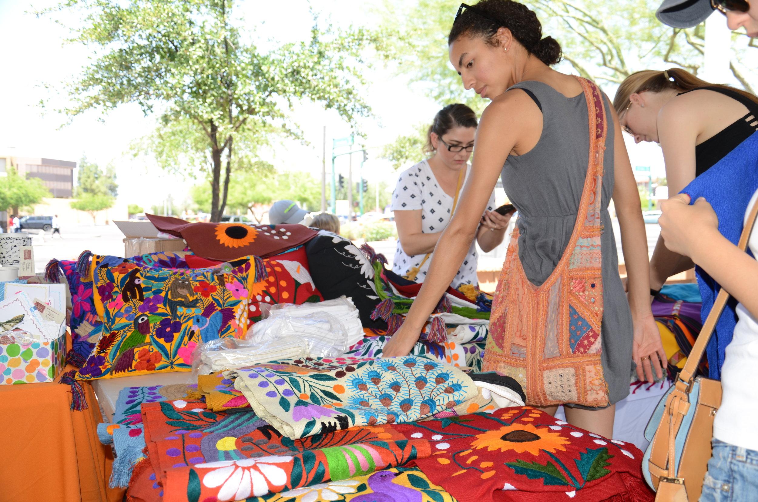 Shoppers browse handmade goods at the World Bazaar & Phoenix Community Market