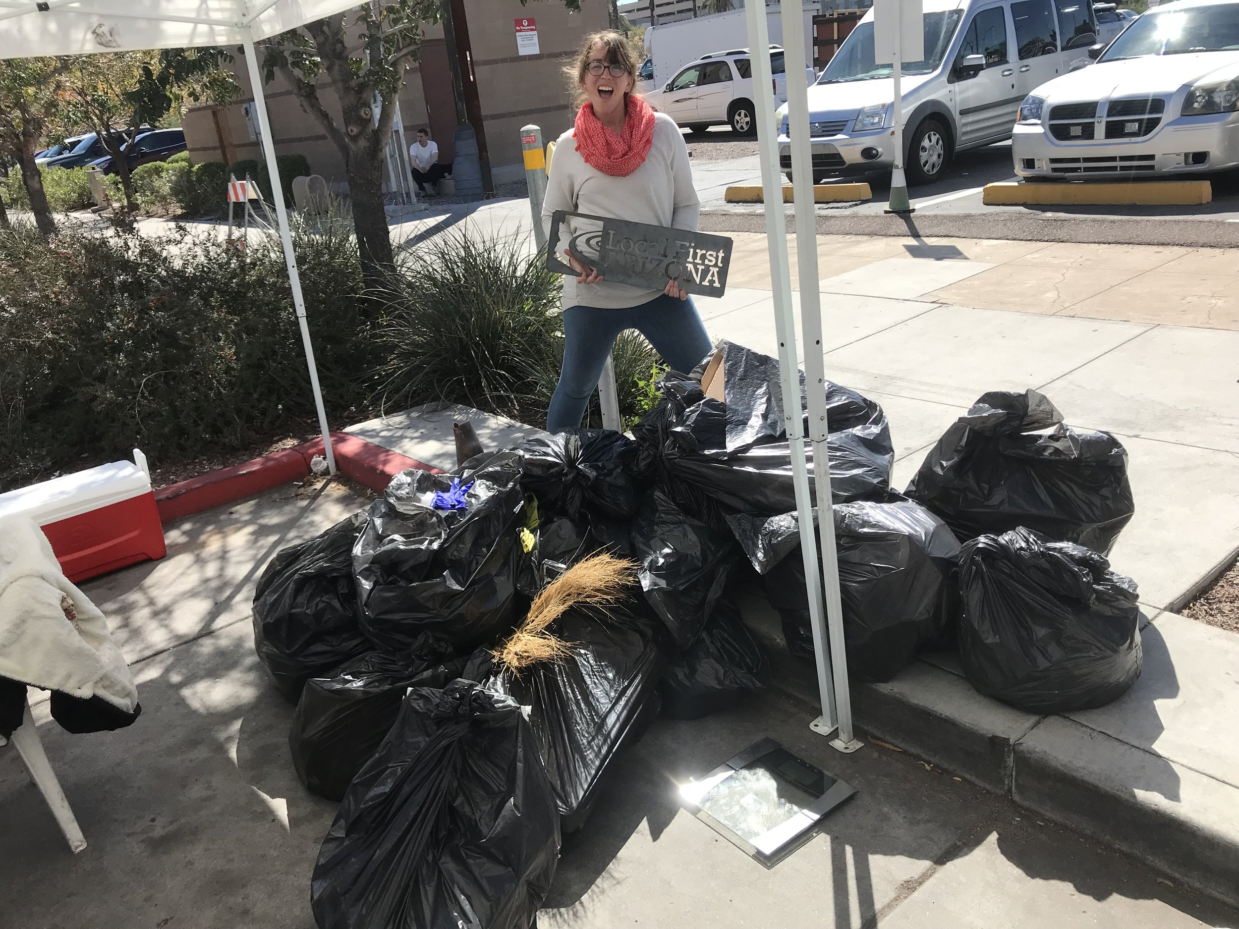 A Green Team member with 125 pounds of waste!