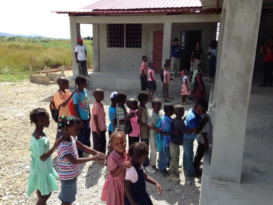 The students line up to go back into class at their new school.