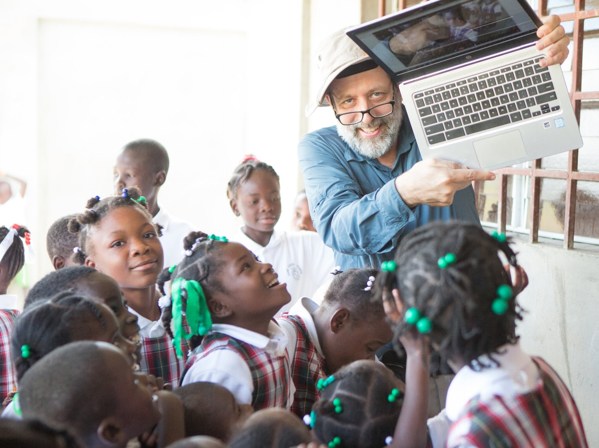"""Scott Grosse, public health economist, Atlanta  """"Educating and empowering girls (and boys) is perhaps the best long-term investment in community health. I was attracted to the opportunity to contribute to a new school built by and for Haitians and run on sustainable principles. A bonus was the goat project! My PhD research project found that children in farm households in Africa are healthier and grow better if there is a goat in the household. In 3 trips to the EcoVillages since 2013 I have been privileged to see a school take shape and blossom and to see hope and joy on the faces of the children, parents, teachers, and community leaders."""""""