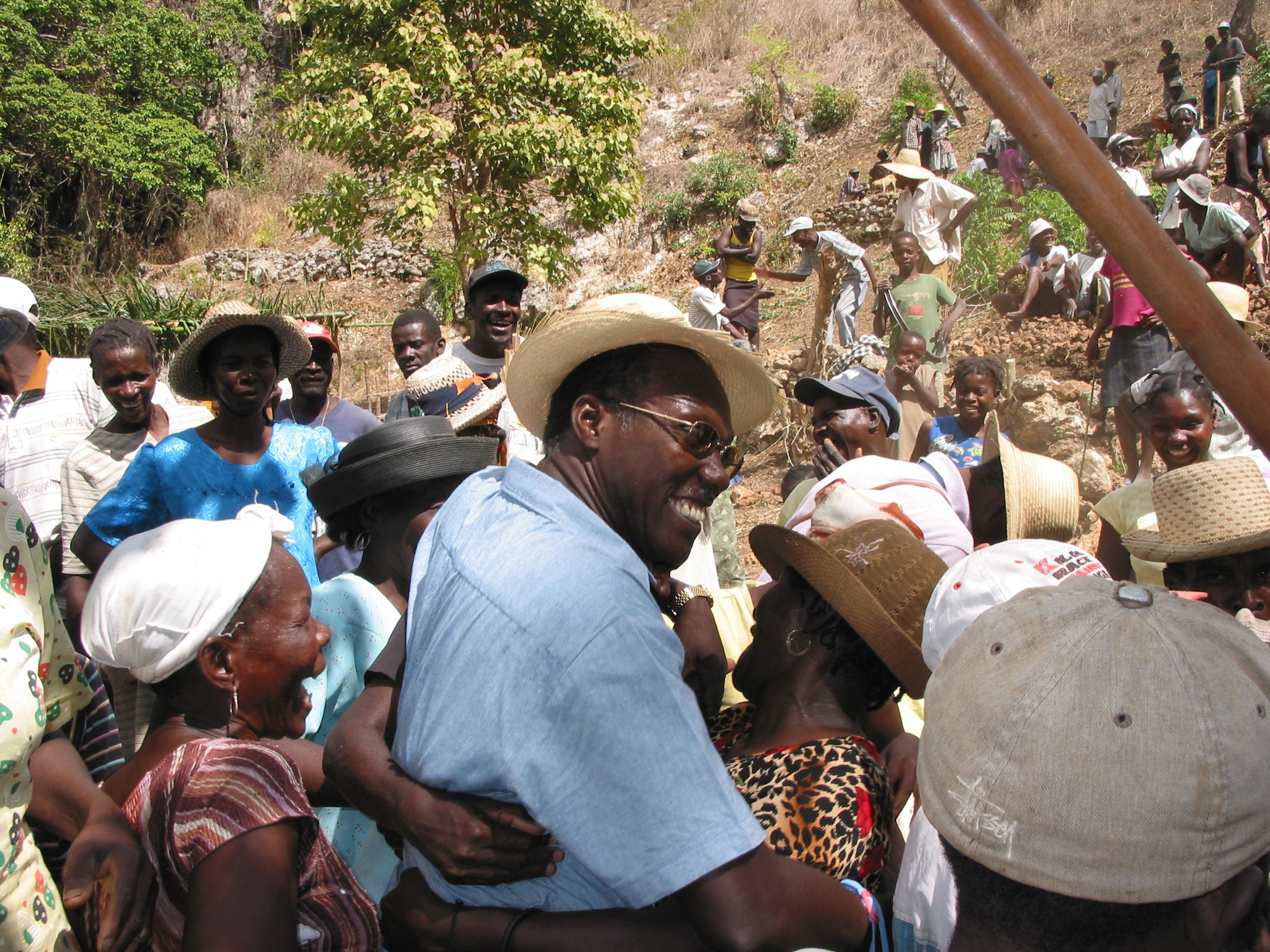 Chavannes Jean-Baptiste, 2005 Goldman Environmental Prize Winner, Islands & Island Nations (Haiti), at a traditional konbit--a communal work day spent building walls to conserve the soil.