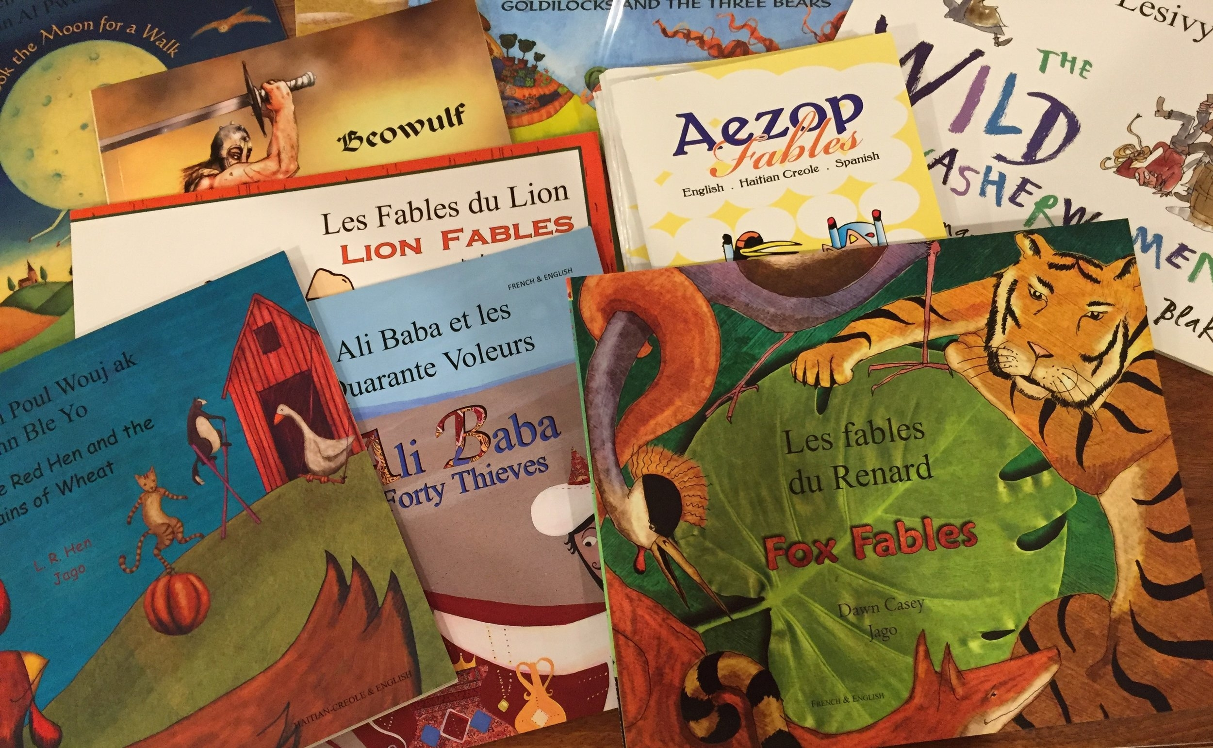 Many of the early readers are in two languages – English & Kreyol or French & Kreyol – with familiar titles designed to expose children to the stories of the world. They will learn about the Little Red Hen, Aesop's fables and Beowulf.