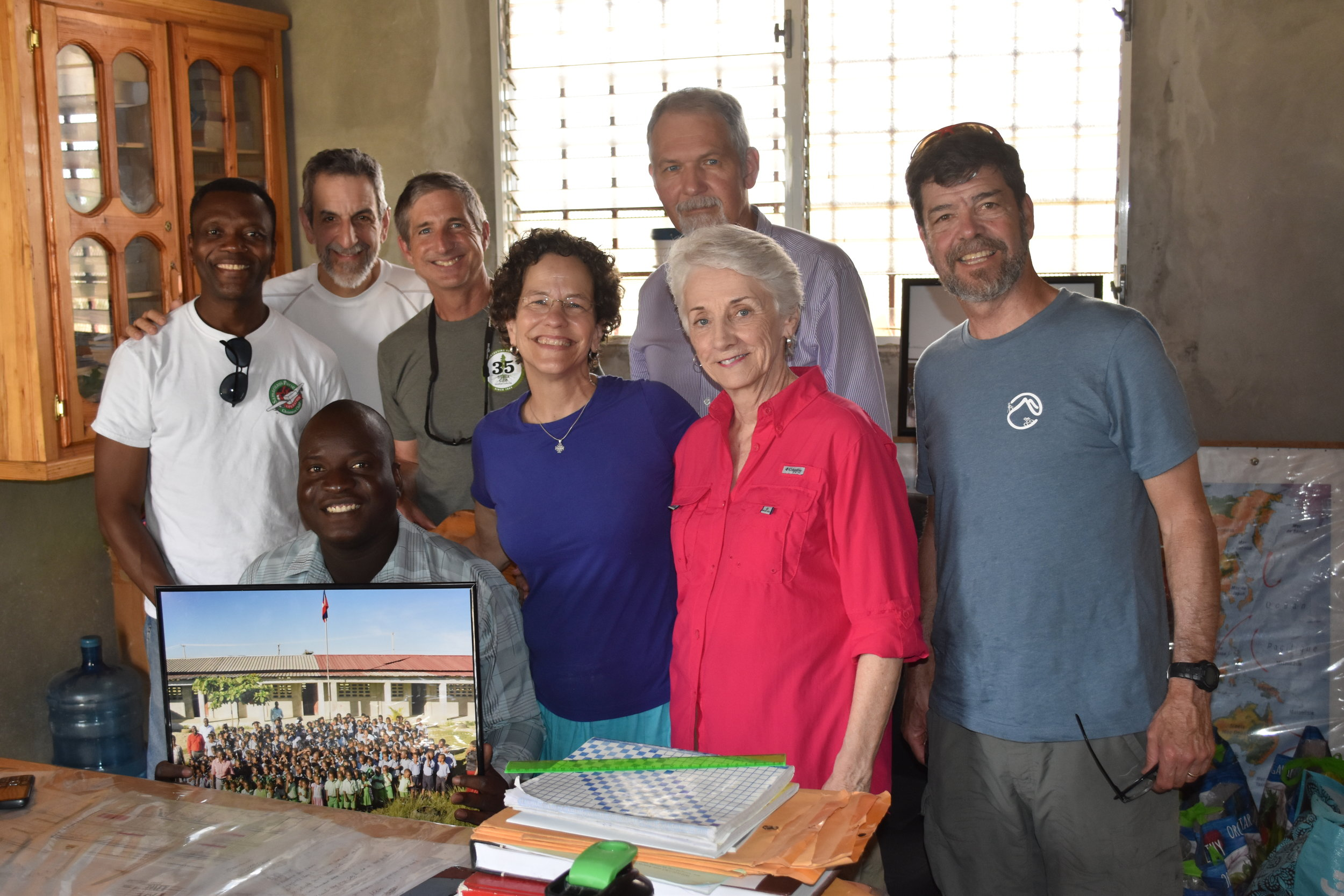 Our delegation with the principal of the school we're helping to build.