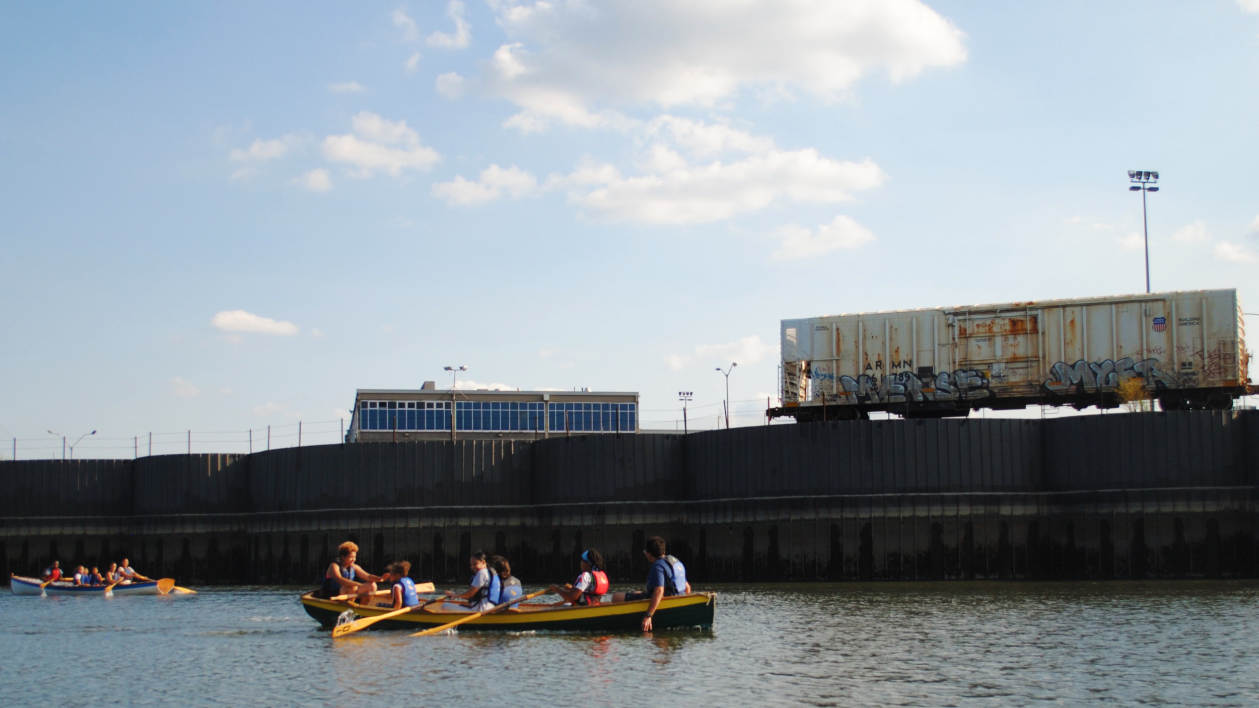 02 Hunts Point Riverside Park Canoe with Grafiti train 2017.jpg