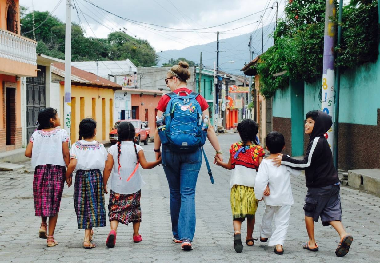 volunteer-walking-with-Guatemalan-children.jpg