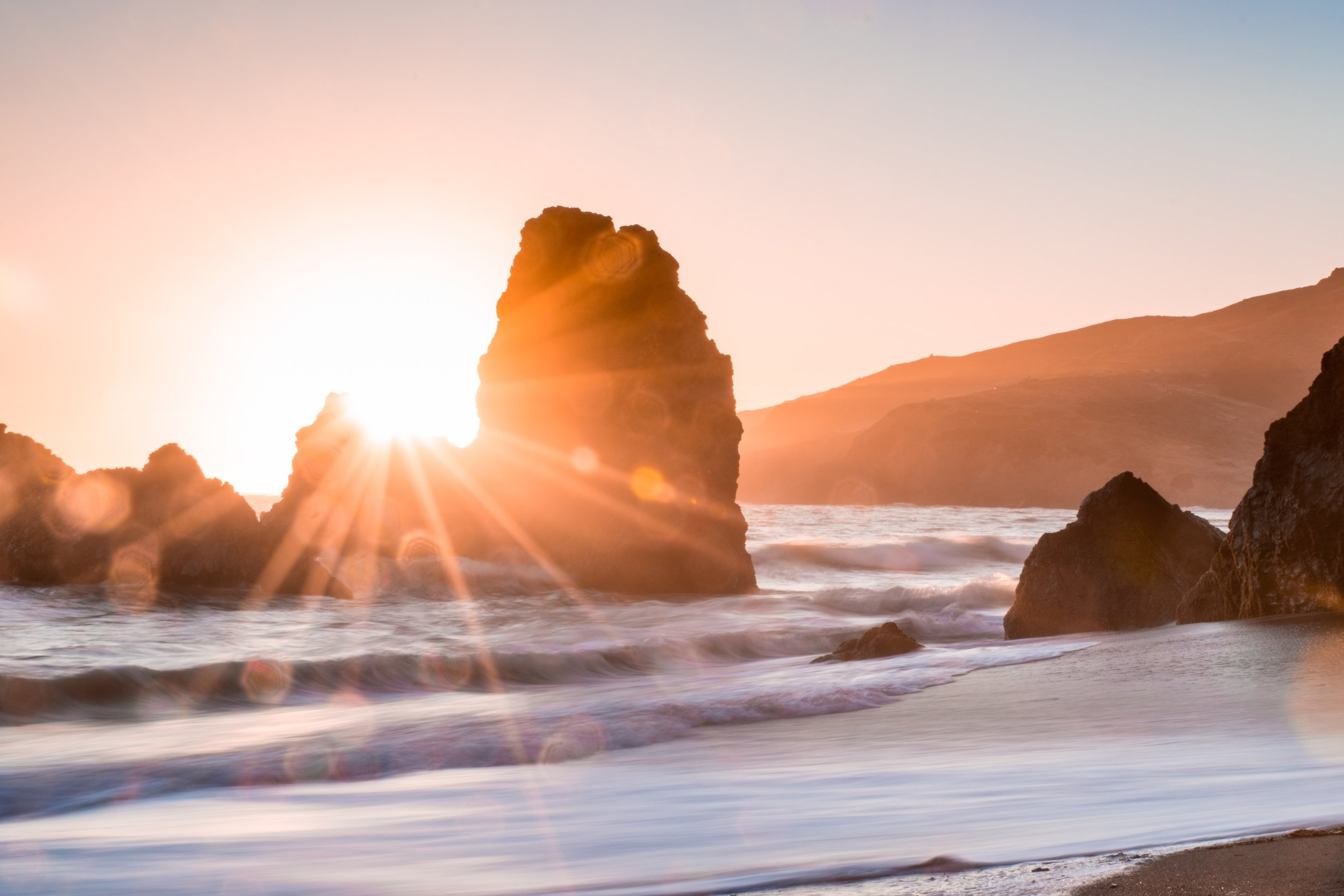 sun_ocean_rock.jpg