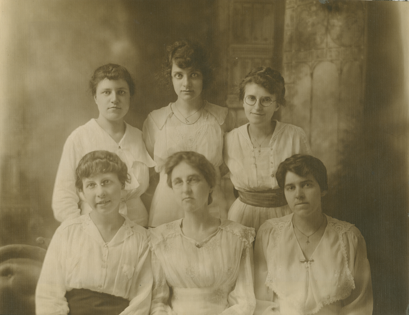 A photo of the matrons. Irene Butts, later Irene Mullins, is back right with round glasses.