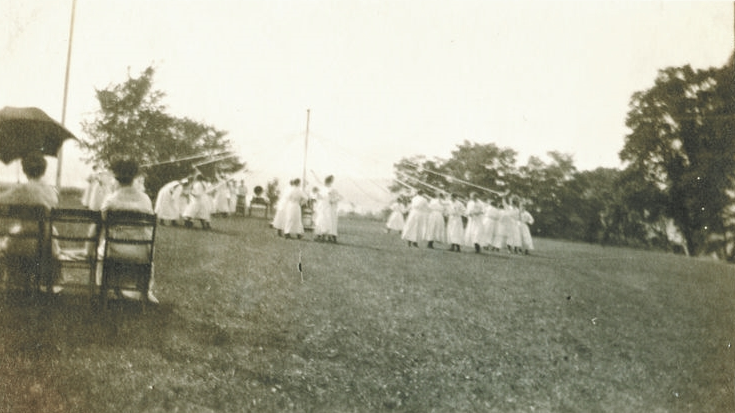 The girls of the training school celebrate the arrival of May with a maypole dance in this early photo.