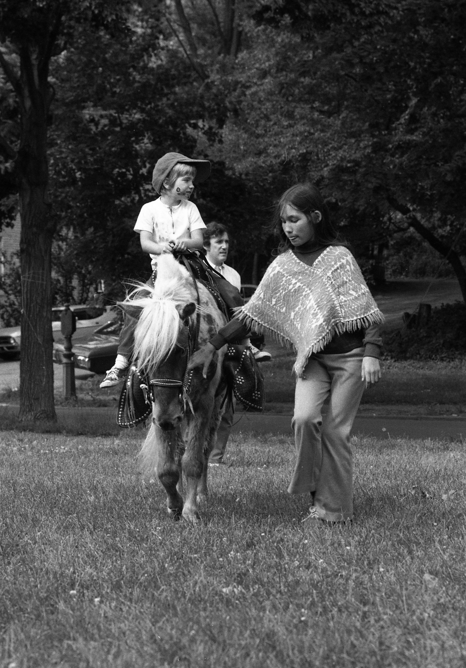 Picture 14: Pony Ride: It is interesting to note that there is a Police Call Box, apparently still functioning, on the left side of the photo near the tree.