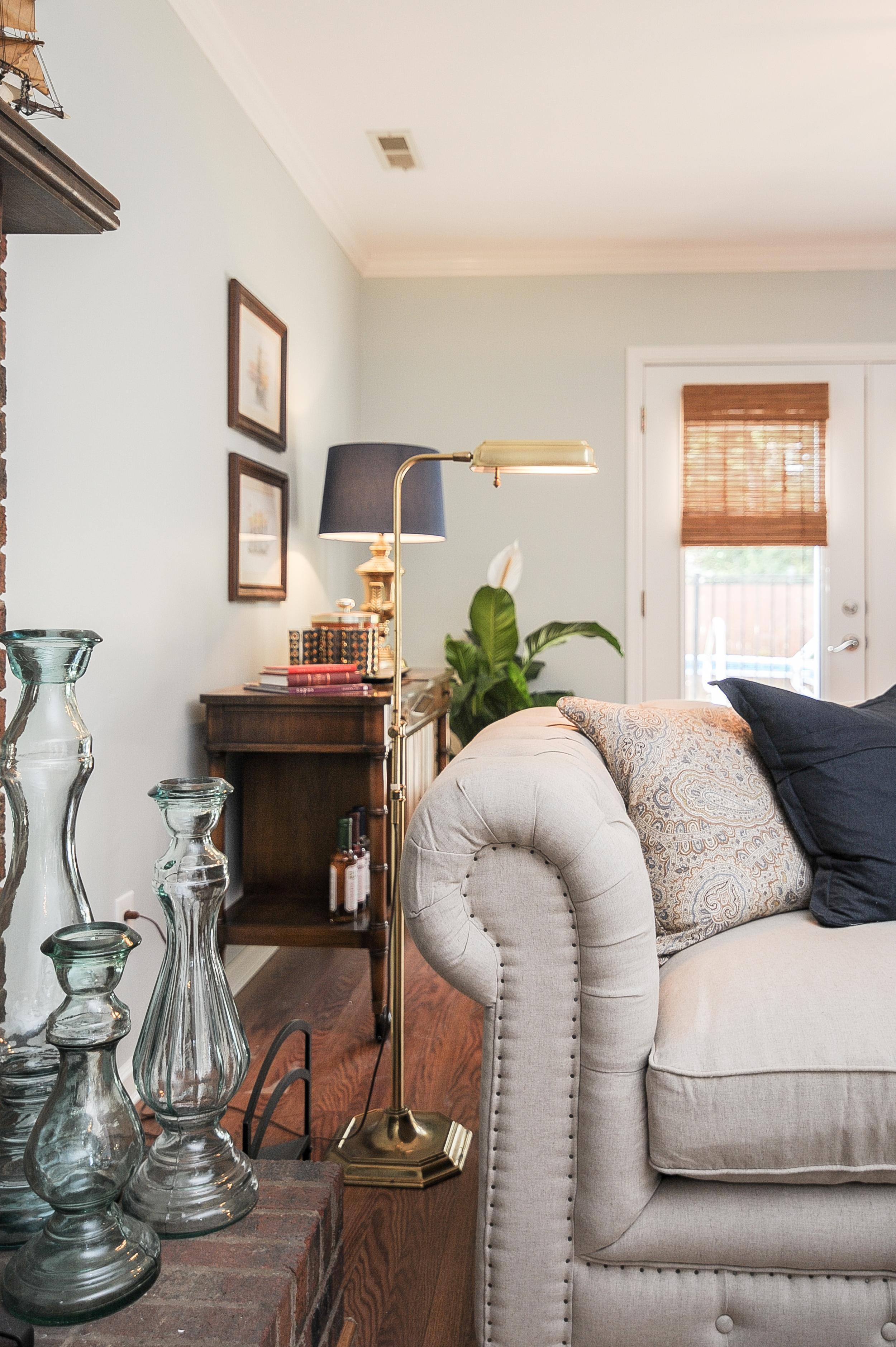Artful Interiors - Bachelor Pad - Living Room Glass Display