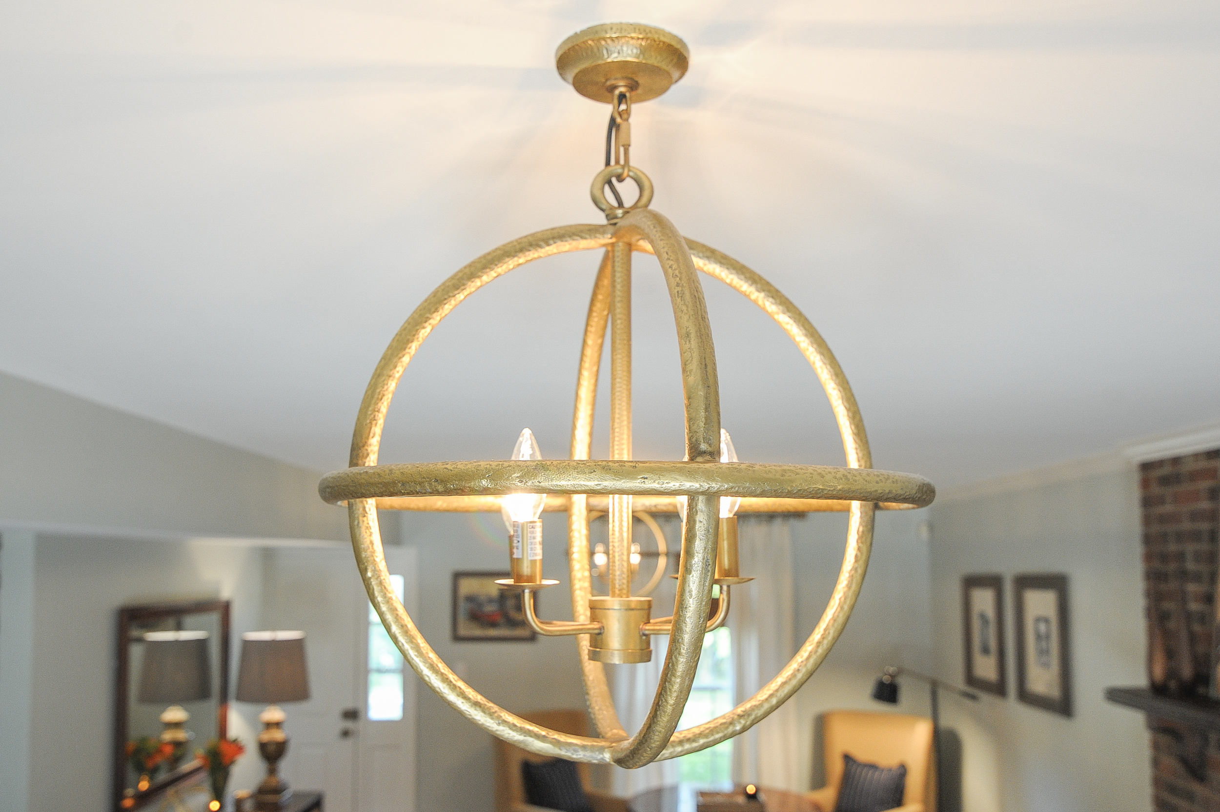 Artful Interiors – Bachelor Pad - Living Room Globe Light