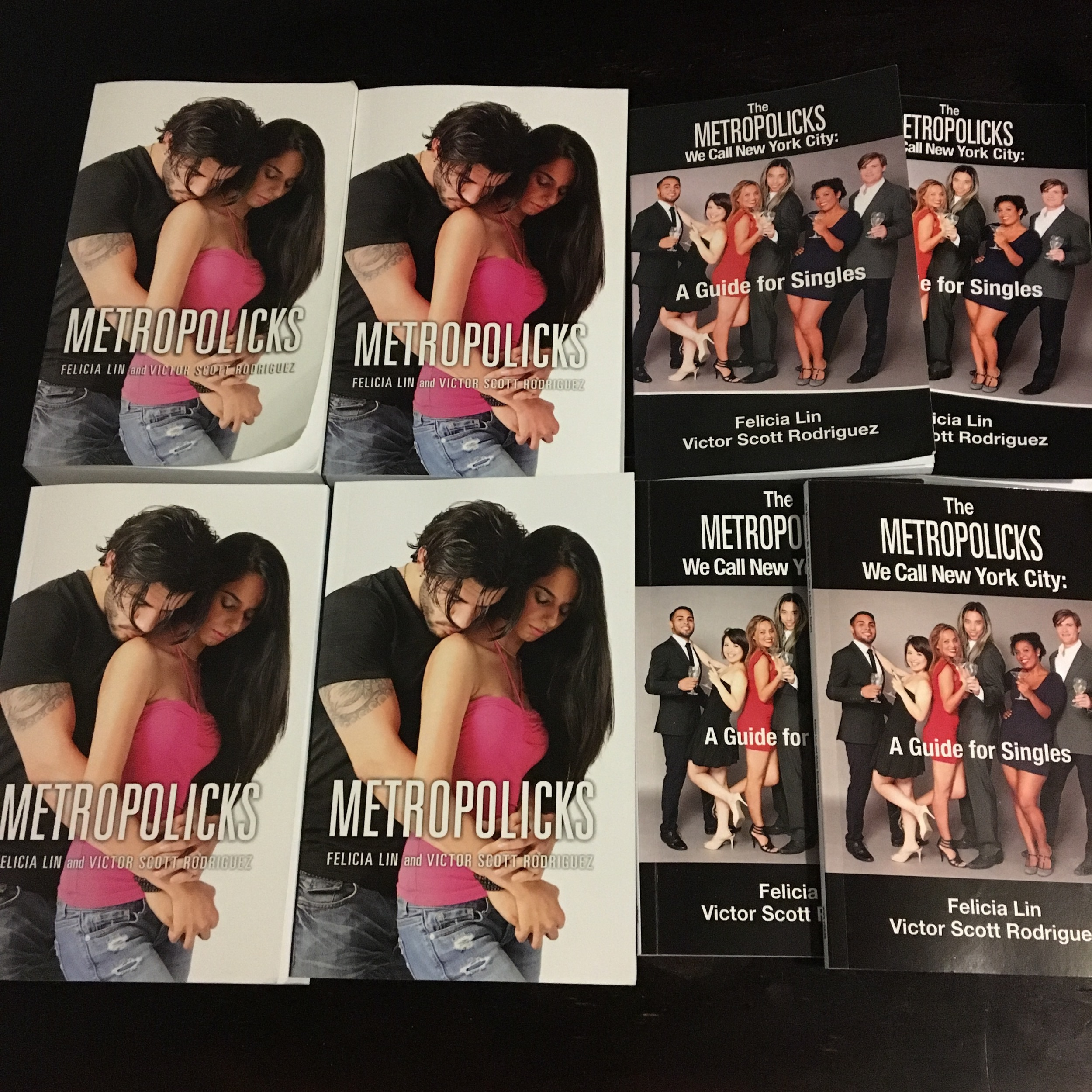 Just a few of the print proof copies of  Metropolicks  and  Metropolicks We Call New York City: A Guide for Singles that we've ordered and proofed before the books hit the presses.