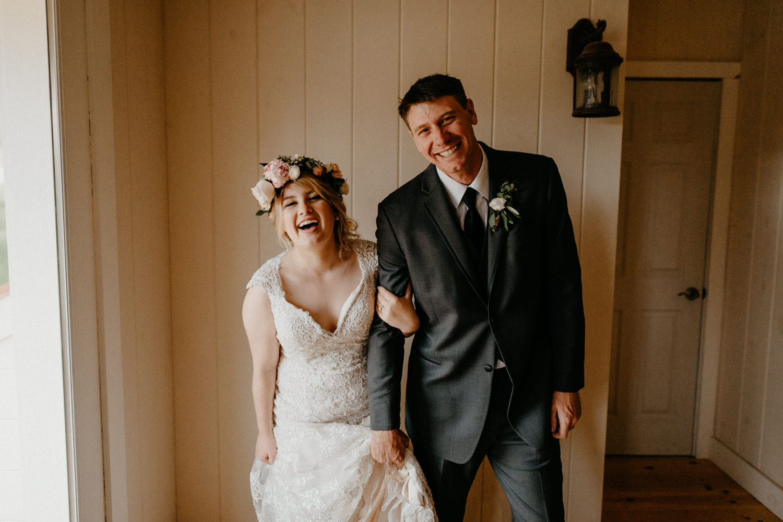 Newlyweds inside on rainy wedding day.jpg