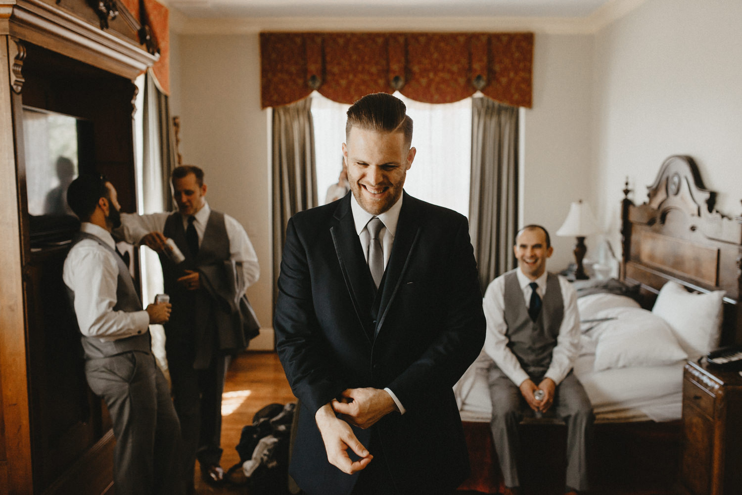 a man getting married in chico ca gets his jacket on at hotel di