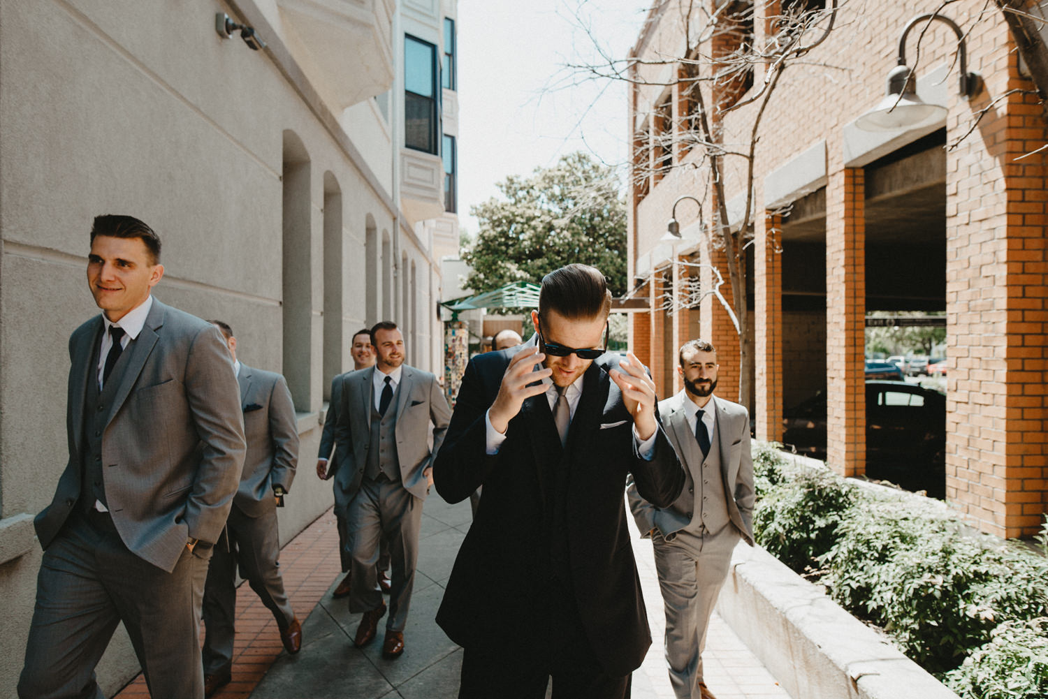 groomsmen walk together outside of hotel diamond in chico ca